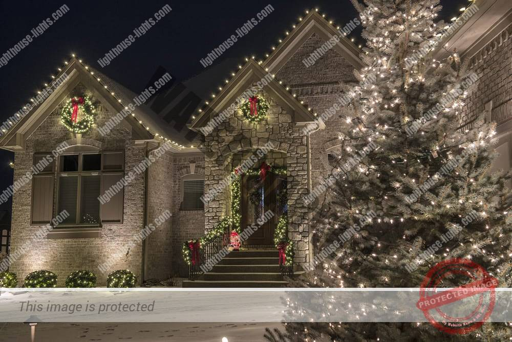 Front of Home with Beautiful Holiday Lighting Design