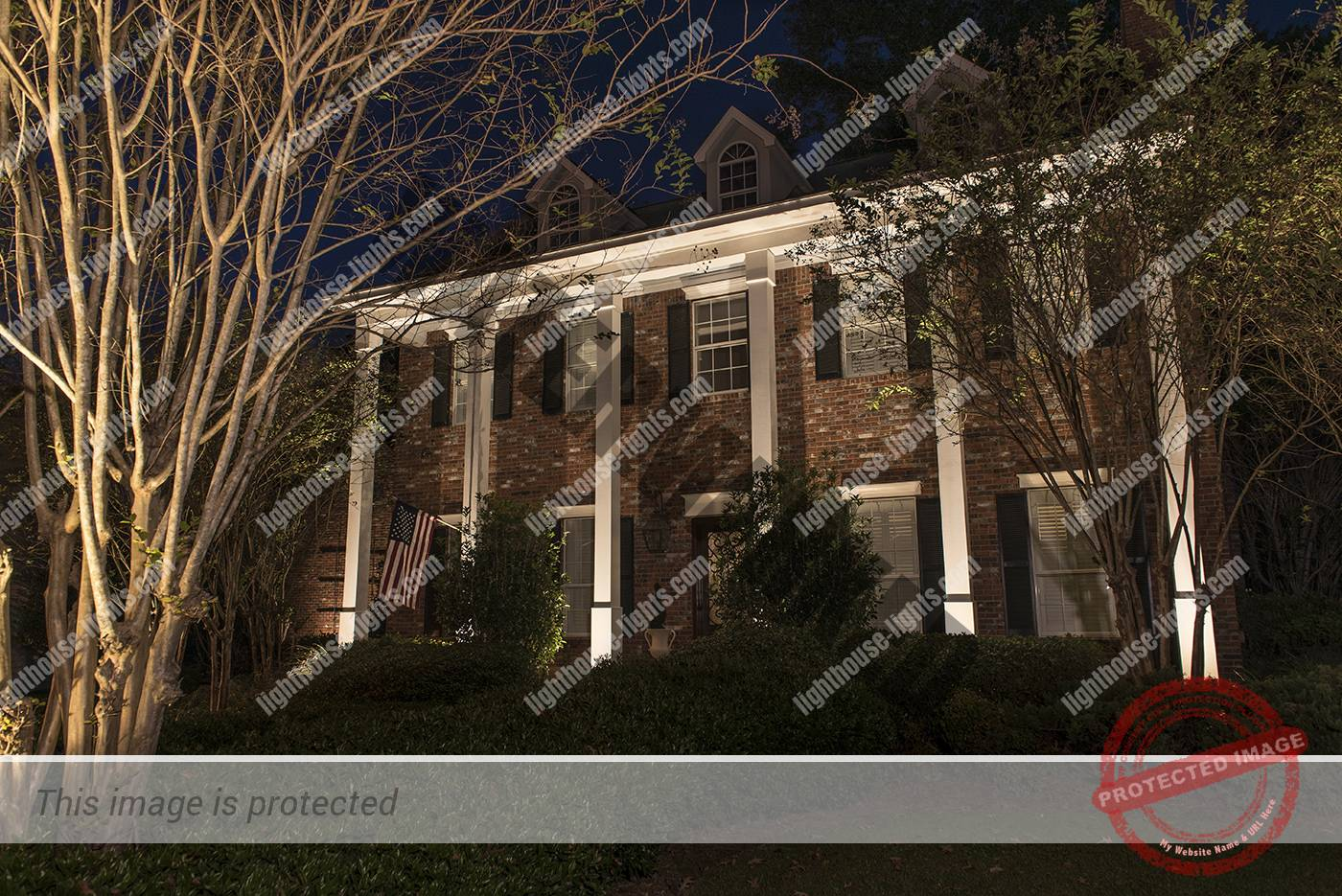 Closeup of of Brick Home with Lighted Columns