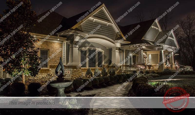 Home with Finished Landscape Lighting Design at Night