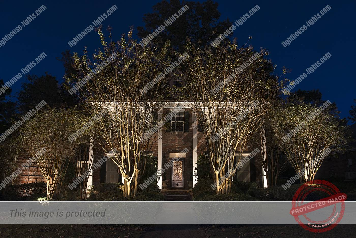 Brick Home in Jackson with Various Outdoor Lighting Techniques