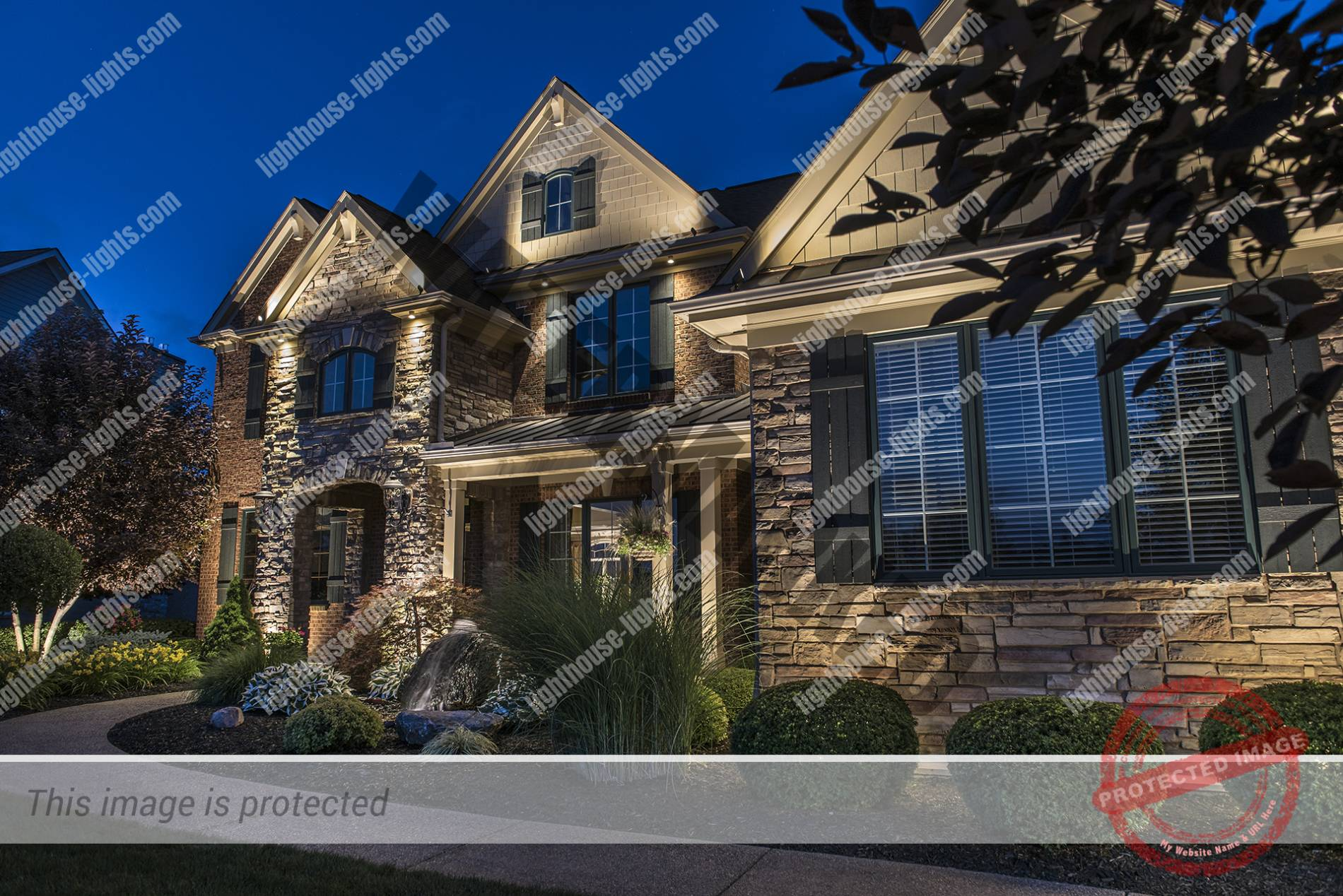 Gorgeous Stone and Brick Home - Lighthouse Landscape Lighting