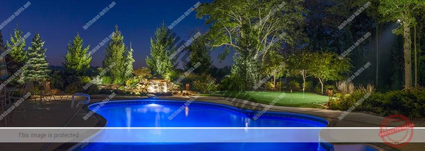 Pool, Trees, and Garden with Landscape Lighting
